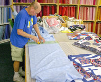 Bill cuts backing for Operation Mend quilt
