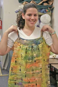 Young lady shows her handmade smock